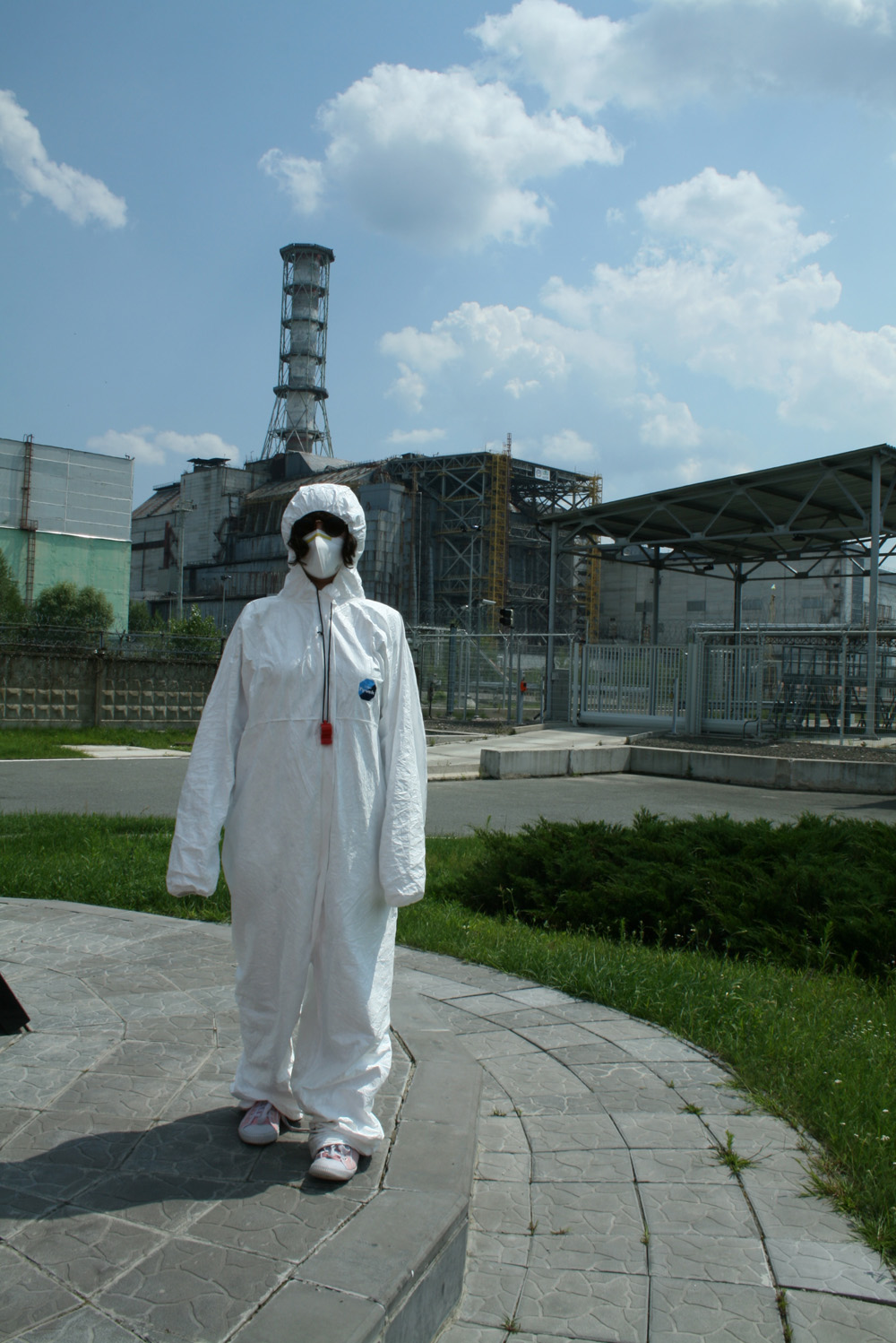 Nelly Ben Hayoun in front of Chernobyl nuclear reactor sarcophagus